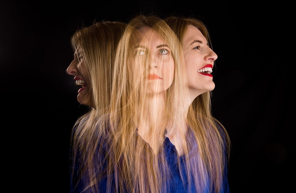 A multi-emxposure image of a woman having mixed emotions.